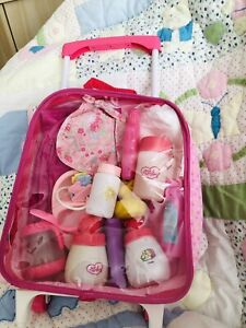 Dolls Trolly And Contents In Good Condition Nappies Bib Change Mat  Bottles Etc