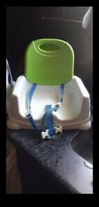 Baby chair color white and green still in good condition,