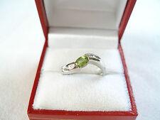 .57 Ct. Peridot Solitaire & Diamond  10k White Gold Ring