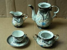 VINTAGE 5-PIECE PORCELAIN TEA SET WITH DRAGONS IN RELIEF