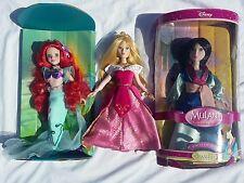 Disney porcelain doll lot. Sleeping Beauty Ariel and Mulan Keepsake dolls stands