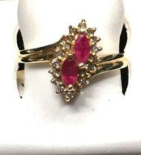LADIES RUBY + DIAMOND RING/2 MARQUISE SHAPED STONES