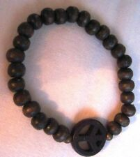 girls Stretch bracelet brown wood beads with Peace sign bead.