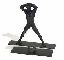 BRUTALIST IRON BOLD NUDE MALE FIGURE BALANCING CONFIDENTLY