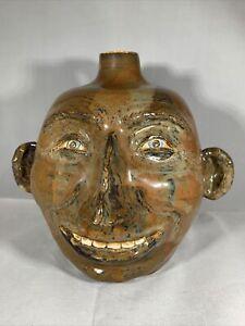 Ugly Face Jug, 7-1/2 tall, signed George Sewell, 5/99, Roswell, Georgia Folk Art