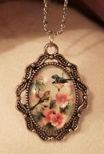Delightful Swooped Rim Openwork Blue Birds Sitting in Flowers Silvertn Necklace