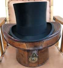 EARLY 20TH CENTURY VINTAGE ARMY & NAVY BLACK SILK TOP HAT & LEATHER HAT BUCKET