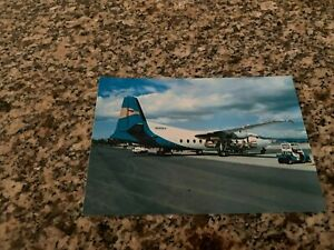 Eagle Airlines Fokker F-27 serviced on the airport ramp postcard