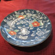 blue decorative plate from japan flowers in the pattern on the plate -