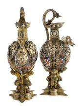 A PAIR OF AUSTRIAN SILVER-GILT, ENAMEL AND GEM-SET EWERS, ATTRIBUTED TO HERMA...
