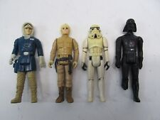 LOT OF 4 VINTAGE STAR WARS FIGURES HAN SOLO SKYWALKER STORM TROOPER DARTH VADER