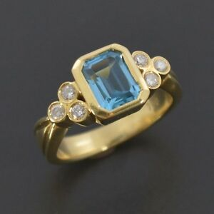 Brand New 18ct Yellow Gold Ring with Emerald Cut Blue Natural Topaz and Diamonds