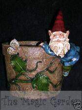 Gnome holding onto pot plant cement concrete garden ornament latex moulds molds