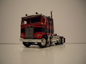 DCP FIRST GEAR 1/64 BLACK AND RED KENWORTH K100 COE WITH SLEEPER CAB