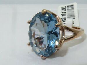 Ladies blue topaz ring oval rose gold 11 carat 14kt steel solitaire london n,p,r