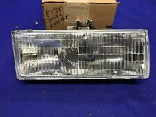 1987 1988 1989 1990 Cadillac Deville LEFT Headlight  NEW NOS GM Part