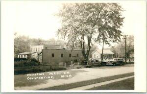 "CONSTANTINE, Michigan RPPC Photo Postcard ""WILLIAMS MFG. CO."" Street View c1940s"