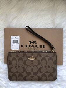 NWT Coach Signature PVC Large Wristlet F58695 - Khaki Saddle