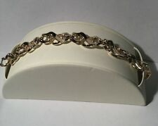 VINTAGE GOLD TONE WHITE ENAMEL INTERTWINED BRACELET SARAH COVENTRY