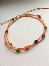 Orange string tie on beads bracelet karmastring puja wrap beach surfer sypsy