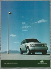 2004 RANGE ROVER advertisement, Range Rover parked under parking lot lights