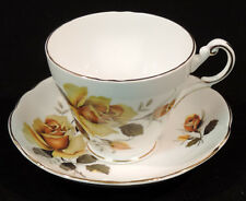 Regency cup & saucer BC gold/yellow colored roses green leaves gold trim England