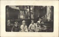 Boys on Lawn & Houses 1911 Wheaton MN Cancel Real Photo Postcard