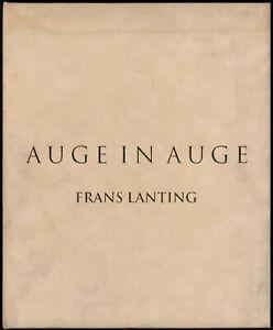 Frans Lanting: Auge in Auge. (1997). Sign. Vorzugsausgabe mit O.-Farbfotografie.