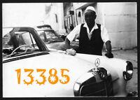 Photograph, boy cleaning Mercedes Ponton car by Fotó dabi BAGHDAD 1960's Iraq