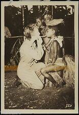 Photo New Britain New Guinea child lighting female 40th div. soldier cigarette