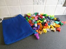 Bundle of 101 mixed Gogos Crazy Bones in a blue cotton bag - clean (vintage)