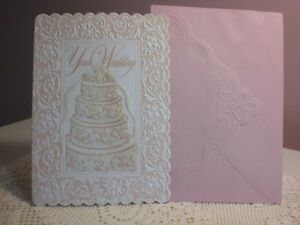 Carol's Rose Garden - Your Wedding - White embossed cake with gold lettering