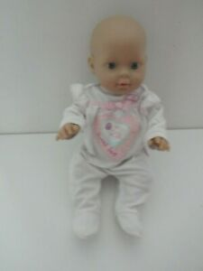 BABY ANNABELL DOLL  IN OUTFIT - CRIES AND VIBRATES    2010
