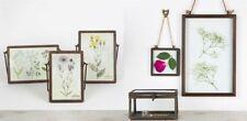 Portafotos y marcos decorativos de metal para el hogar
