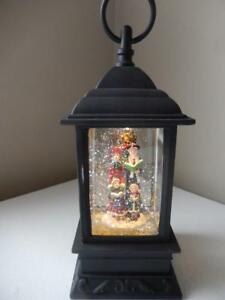 "Raz Imports 9.5"" Carolers Water Lantern - Lighted and has a Blower"