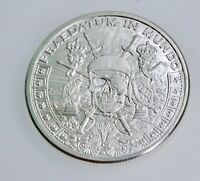 """1 ounce .999 """"Pieces of Eight"""" Pirate Silver Shield coin from BU roll in cap"""