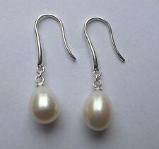 Pendientes de joyería con perlas ganchos