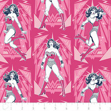 Warner Brothers Wonder Woman Poses in Magenta 100% cotton fabric by the yard
