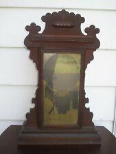Antique Welch gingerbread mantel clock case and pendulum