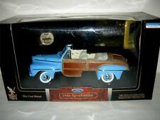 1946 SPORTSMAN IN LITE BLUE SIGNATURE SERIES AND 24K GOLD PLTD. COIN 1:18SC. MIB