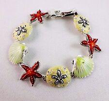 Beach bracelet starfish scallop sand dollar silver base metal Icon Collection