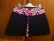 Black miniskirt with floral sixties pattern size 6 or 13 yrs old