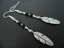 A PAIR OF  TIBETAN SILVER LONG DANGLY  FEATHER THEMED EARRINGS. NEW.