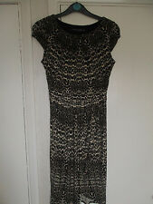 A size 10 sleeveless animal print brown and white dress from Dorothy Perkins