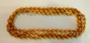 Antique Very long opera length faux amber individually knotted beads