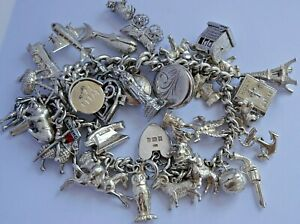 Stunning vintage solid silver charm bracelet & 36 charms,rare,open.move.116.8g