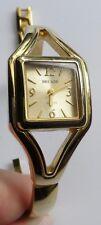 montre bijou femme rétro couleur rhodié or quartz signé semi rigide 588