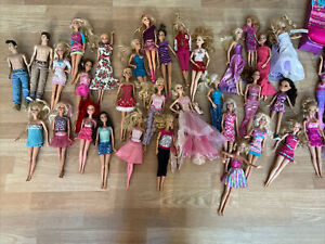 Lot 34 Mattel Barbie Dolls, Cloths & Misc Accessories