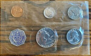 Two 1961 U.S. Mint sets, each with half dollar, quarter, nickel, dime, penny