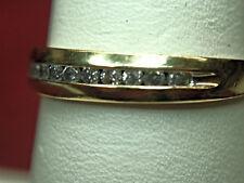 10K YELLOW GOLD DIAMOND WEDDING BAND - 1/8 CTW CHANNEL SET STONES